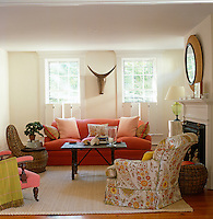 Comfortable living room with sofa and armchairs grouped around a small coffee table