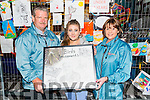 Local Killarney Artist Katie Mai Moloney presented her Art competition entry to Don Bird of Birds Bazaar pictured with Don's wife Yvonne Bird at the Birds Bazaar, Killarney last Saturday evening.