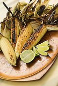 Grilled local sweet corn drizzled with fresh lime.