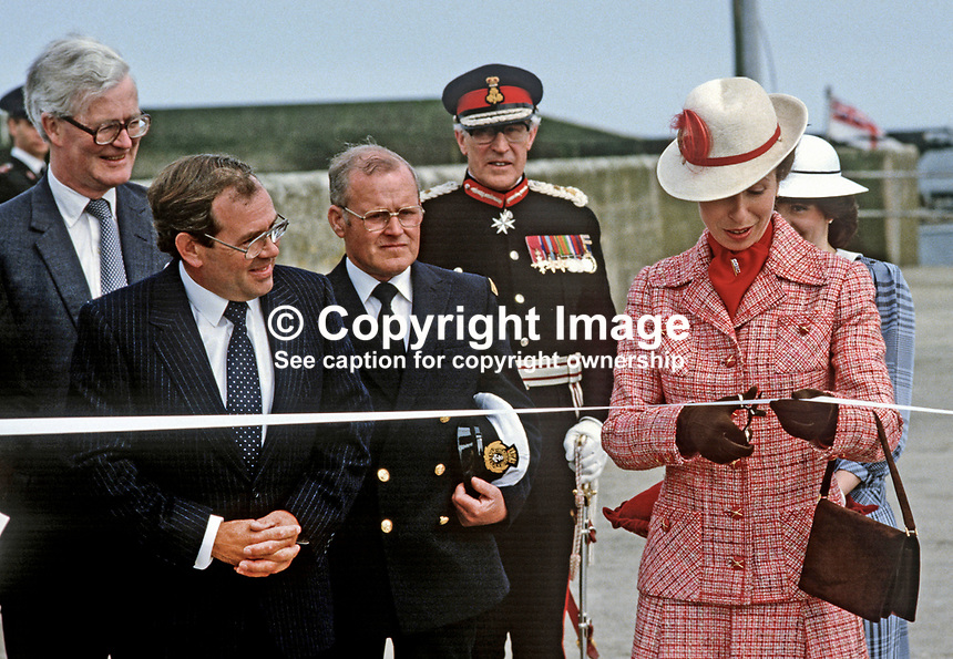 Princess Anne on a May 1985 Royal Visit to N Ireland to officially re-open the harbour in the Co Down fishing village of Portavogie following extensive improvements. Also in the photo is Douglas Hurd, Secretary of State for N Ireland. 19850502g.<br />