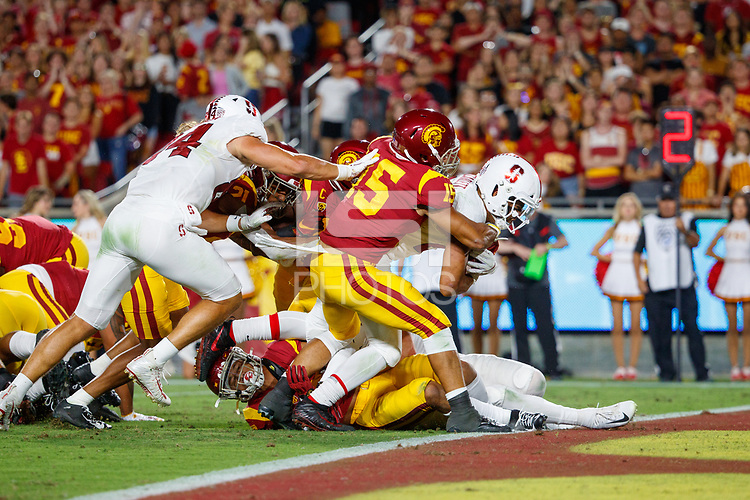 LOS ANGELES, CA - SEPTEMBER 8: Stanford Cardinal running back Cameron Scarlett #22 rushes for a touchdown during a game between USC and Stanford Football at Los Angeles Memorial Coliseum on September 7, 2019 in Los Angeles, California.