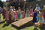 Stowey Female Friendly Society ( The Womens Walk ) Club Day. Local women and flower girls walk from the village to the grave of Tom Poole the founder of the society in 1806. The Rev Craig Marshall St Mary's Church where a prayer is said around the grave followed by a church service. Nether Stowey Somerset UK 2014. 208th Club day walk.