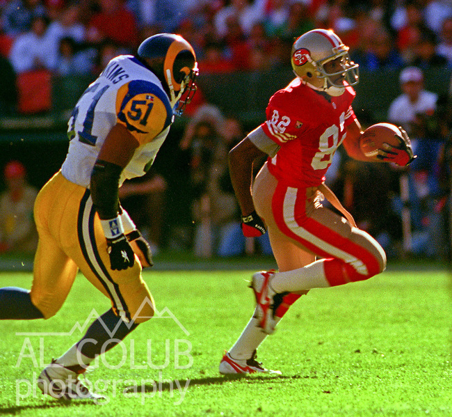 San Francisco 49ers vs. St. Louis Rams at Candlestick Park Sunday, November 26, 1995.  49ers beat Rams  41-13.  St. Louis Rams linebacker Carlos Jenkins (51) chases San Francisco 49ers wide receiver John Taylor (82).