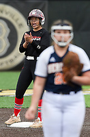NWA Democrat-Gazette/CHARLIE KAIJO Northside High School Danessa Teague (4) cheers during the 6A State Softball Tournament, Thursday, May 9, 2019 at Tiger Athletic Complex at Bentonville High School in Bentonville. Rogers Heritage High School lost to Northside High School 8-6