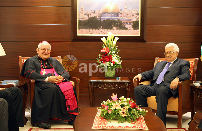 Palestinian President Mahmoud Abbas (Abu Mazen) meets with President of the Pontifical Mission in the West Bank city of Ramallah, on 02 August 2012. Photo by Thaer Ganaim