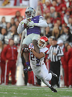 NWA Democrat-Gazette/MICHAEL WOODS • @NWAMICHAELW<br /> University of Arkansas defender Jared Collins (29) makes the tackle on Kansas State receiver Deante Burton (6) in the 2nd quarter of the Razorbacks 45-23 win over Kansas State in the 57th annual AutoZone Liberty Bowl January 2, 2016.