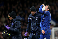 Andreas Christensen of Chelsea walks off the pitch to receive further treatment after suffering a facial injury during Chelsea vs Manchester United, Premier League Football at Stamford Bridge on 17th February 2020