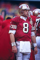 SAN FRANCISCO, CA - Quarterback Steve Young of the San Francisco 49ers on the sidelines during a game at Candlestick Park in San Francisco, California in 1994. Photo by Brad Mangin