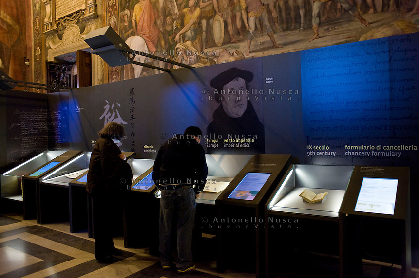 "La mostra sui segreti del Vaticano apre nei Musei Capitolini. Un evento storico senza precedenti con 100 documenti originali provenienti dall'archivio Segreto Vaticano..""Lux in Arcana – The Vatican Secret Archives Reveals Itself"" exhibition, opens in the splendid halls of Rome's Capitoline Museums. An unprecedent cultural and media event: 100 original documents, preserved for 400 years in the papal archives, have crossed the boundaries of Vatican City for the first time ever, in order to be put on display at the Capitoline Museums in Rome."