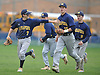 Matthew Pinto #7, Massapequa right fielder, left, heads back to the dugout with teammates after making a diving catch to end the bottom of the sixth inning of a Nassau County varsity baseball game against host Oceanside High School on Monday, April 24, 2017. Oceanside won by a score of 9-7.