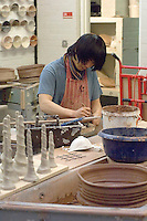 Potter at work, University College for the Creative Arts, Farnham.