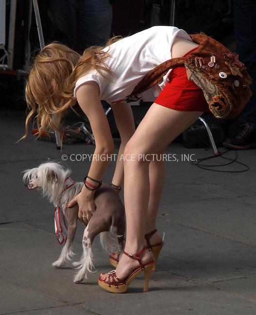 Ashley Olsen and Mary-Kate Olsen filming their latest movie, 'New York Minute.' New York, October 6, 2003. Please byline: NY Photo Press.   ..*PAY-PER-USE*      ....NY Photo Press:  ..phone (646) 267-6913;   ..e-mail: info@nyphotopress.com