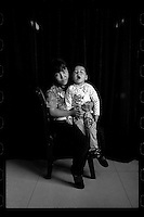 A Chinese woman poses with her daughter before the girl's cleft palate operation organized by Smile Angel Foundation at a hospital in Xining, Qinghai province, China, August 2013. (Names withheld for privacy)