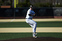 Wake Forest Demon Deacons starting pitcher Jared Shuster (14) in action against the Louisville Cardinals at David F. Couch Ballpark on March 7, 2020 in  Winston-Salem, North Carolina. The Demon Deacons defeated the Cardinals 3-2. (Brian Westerholt/Four Seam Images)