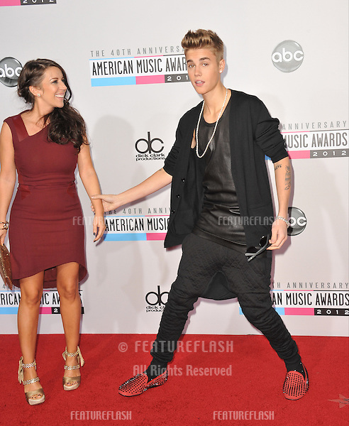 Justin Bieber & mother at the 40th Anniversary American Music Awards at the Nokia Theatre LA Live..November 18, 2012  Los Angeles, CA.Picture: Paul Smith / Featureflash
