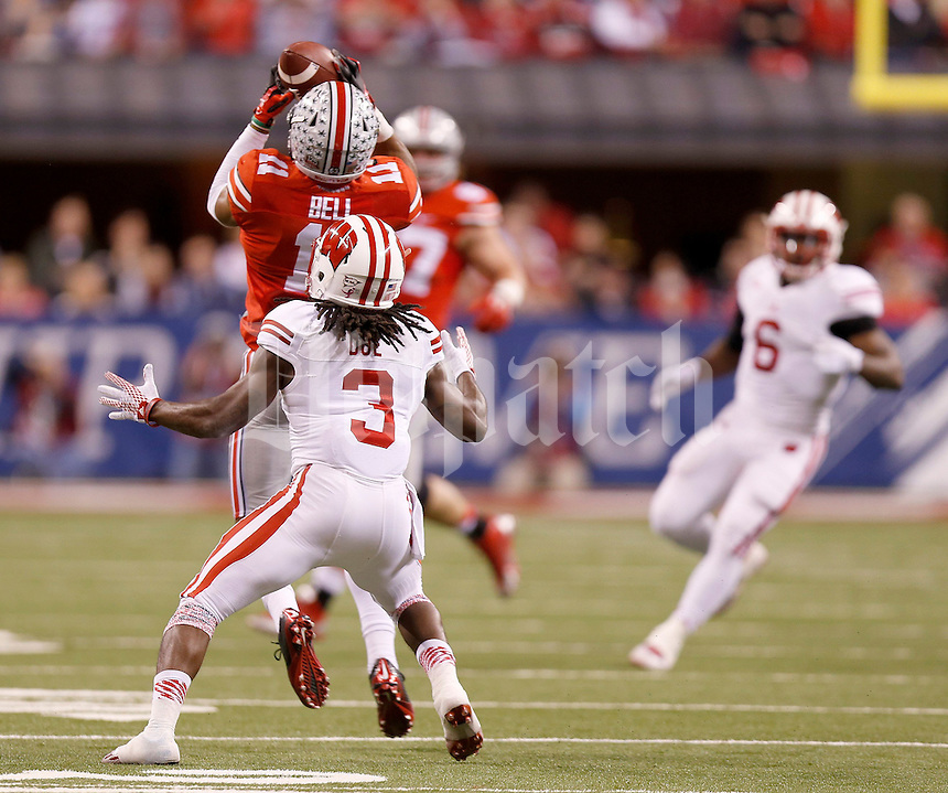 Ohio State Buckeyes defensive back Vonn Bell (11) intercepts a pass in front of Wisconsin Badgers wide receiver Kenzel Doe (3) in the first quarter of the Big Ten Championship game at Lucas Oil Stadium in Indianapolis on Saturday, December 6, 2014. (Columbus Dispatch photo by Jonathan Quilter)