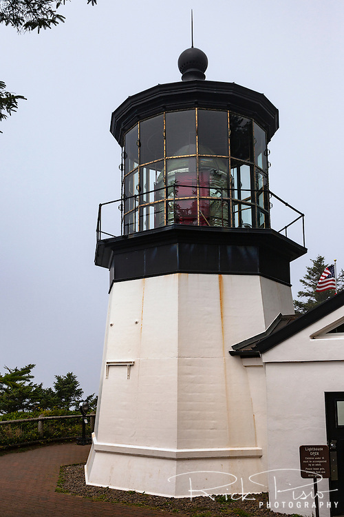 Cape Meares Lighthouse along Oregon's Northern Coast. The 38 foot high lighthouse tower was built in 1889 and commissioned on January 1, 1890. It is the shortest lighthouse in Oregon.