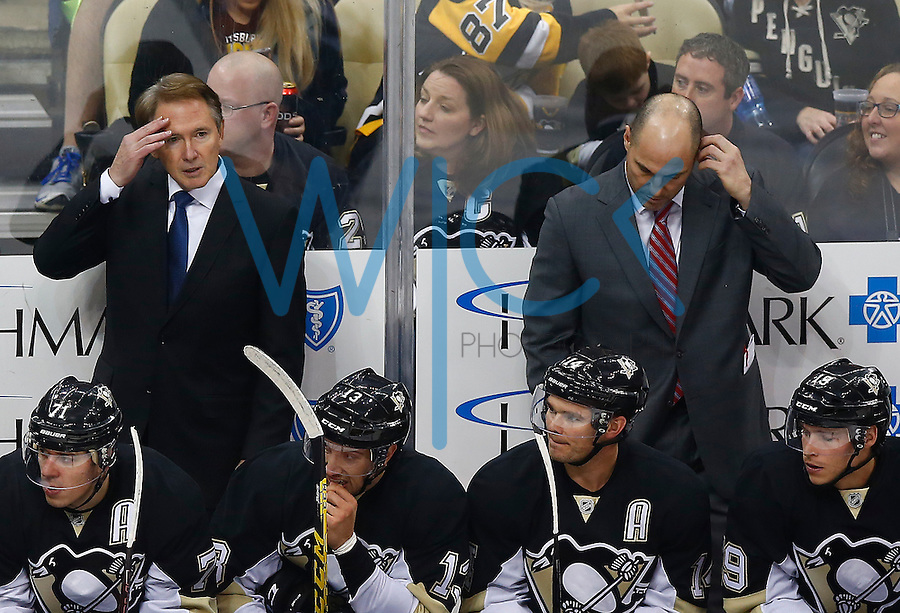 Head coach Mike Johnston of the Pittsburgh Penguins looks on in the first period against the Colorado Avalanche during the game at Consol Energy Center on November 19, 2015. (Photo by Jared Wickerham/DKPittsburghSports)