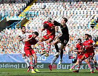 Leeds United's Liam Cooper tries to compete in the air with Barnsley's Jack Walton and Mads Juel Andersen<br /> <br /> Photographer Alex Dodd/CameraSport<br /> <br /> The EFL Sky Bet Championship - Leeds United v Barnsley - Thursday 16th July 2020 - Elland Road - Leeds<br /> <br /> World Copyright © 2020 CameraSport. All rights reserved. 43 Linden Ave. Countesthorpe. Leicester. England. LE8 5PG - Tel: +44 (0) 116 277 4147 - admin@camerasport.com - www.camerasport.com