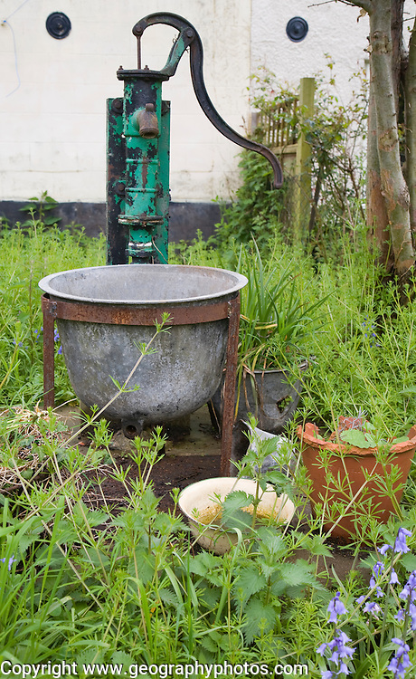 Old household water pump in garden, Shottisham, Suffolk, England