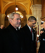 Washington, DC - January 20, 2009 -- United States President-elect Barack Obama (R) walks with President George W. Bush as they arrive to the U.S. Capitol for the inaugural ceremony in Washington, Tuesday, January 20, 2009. .Credit: Molly Riley - Pool via CNP