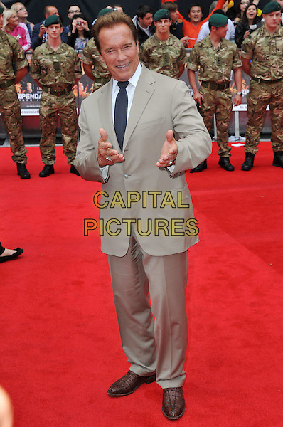 Arnold Schwarzenegger.The 'The Expendables 2' UK film premiere, Empire cinema, Leicester Square, London, England..August 13th, 2012.full length beige suit tie black tie white shirt hands arms.CAP/BF.©Bob Fidgeon/Capital Pictures.
