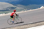 Woman biker on Mount Evans Road, Idaho Springs, Colorado. .  John offers private photo tours in Denver, Boulder and throughout Colorado. Year-round.