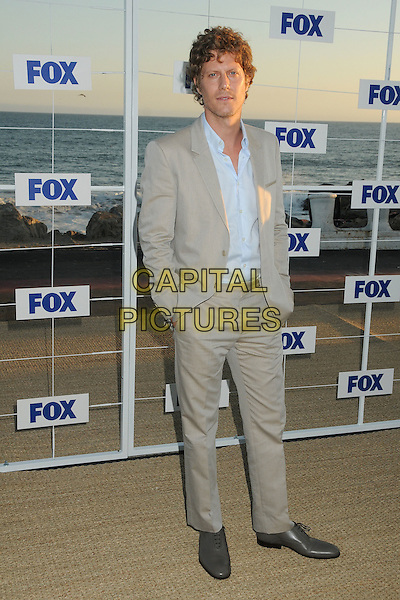 Eric Sheffer Stevens.Fox All Star Party 2011 held at Gladstones Malibu, Pacific Palisades, California, USA, 5th August 2011..full length grey gray suit blue shirt .CAP/ADM/BP.©Byron Purvis/AdMedia/Capital Pictures.