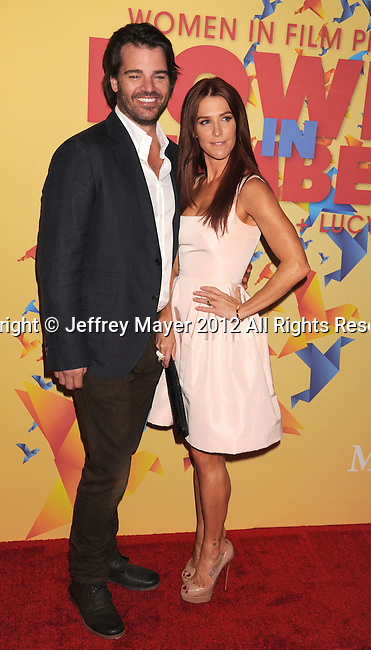 BEVERLY HILLS, CA - JUNE 12: Poppy Montgomery and Adam Kaufman arrives at the 2012 Women In Film Crystal + Lucy Awards at The Beverly Hilton Hotel on June 12, 2012 in Beverly Hills, California.