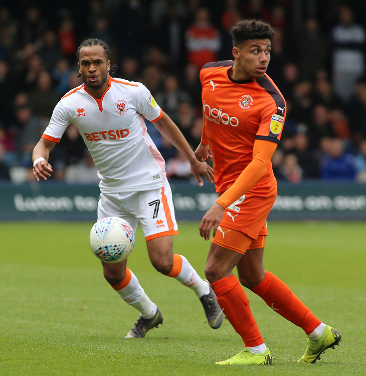 Blackpool's Nathan Delfouneso chases down Luton Town's James Justin<br /> <br /> Photographer David Shipman/CameraSport<br /> <br /> The EFL Sky Bet League One - Luton Town v Blackpool - Saturday 6th April 2019 - Kenilworth Road - Luton<br /> <br /> World Copyright © 2019 CameraSport. All rights reserved. 43 Linden Ave. Countesthorpe. Leicester. England. LE8 5PG - Tel: +44 (0) 116 277 4147 - admin@camerasport.com - www.camerasport.com