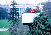 First lady Barbara Bush holds grandson Walker Bush, as she and Joseph H. Riley, place the main ornament on top of the National Christmas Tree on the Ellipse in Washington, DC on December 1, 1992. <br /> Credit: Jeff Markowitz / Pool via CNP