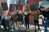 Protesters hold up blank cardboard representing blacked out computer screens. Several hundred members and supporters of the NY Tech Meetup group protest outside the offices of US Senators Kirsten Gillibrand and Charles Schumer in New York on Wednesday, January 18, 2012 over legislation concerning online piracy. The demonstrators were against the proposed Stop Online Piracy Act (SOPA) and the Protect IP Act (PIPA) which they feel will allow US authorities to shutdown websites that are accused of online piracy without due process and threatens the freedom of the internet. (© Richard B. Levine)