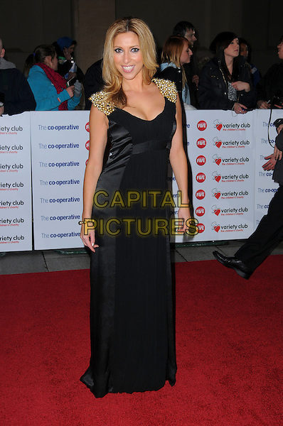 KATE WALSH .The Co-operative Variety Club Showbiz Awards, Grosvenor House Hotel, Park Lane, London, England, UK, .14th November 2010. .full length  gold shoulders cleavage long maxi black dress beaded .CAP/CAS.©Bob Cass/Capital Pictures.
