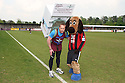 Histon fan and ex-para Pete Digby who is running the London Marathon with an 80lb washing machine strapped to his back with the Histon mascot before the Blue Square Bet Premier match between Histon and AFC Wimbledon at the Glass World Stadium, Histon on 16th April, 2011.© Kevin Coleman 2011.