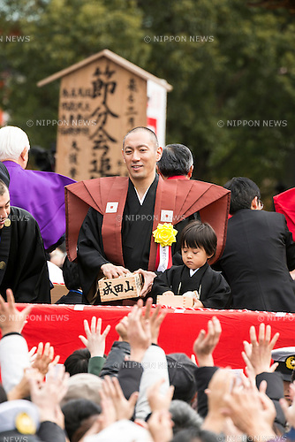 Kabuki actor Ichikawa Ebizo XI with his son throw beans during a Setsubun festival at Naritasan Shinshoji Temple on February 3, 2016, in Chiba, Japan. Setsubun is an annual Japanese festival celebrated on February 3rd and marks the day before the beginning of Spring. Celebrations involve throwing soybeans (known as mamemaki) out of the house to protect against evil spirits and into the house to invite good fortune. In many Japanese families one member will wear an ogre mask whilst others throw beans at him or her. The celebration at Naritasan Shinshoji Temple is one of the biggest in Japan and organizers this year expect over 50,000 people to attend the event. Each year famous sumo wrestlers and actors are also invited to participate in throwing the beans. (Photo by Rodrigo Reyes Marin/AFLO)