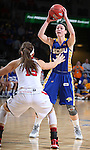 SIOUX FALLS, SD - MARCH 10: Megan Waytashek #24 from South Dakota State University looks for a teammate over the defense of Kelly Stewart #15 from the University of South Dakota in the first half of the Summit League Championship Tournament game Tuesday at the Denny Sanford Premier Center in Sioux Falls, SD. (Photo by Dick Carlson/Inertia)
