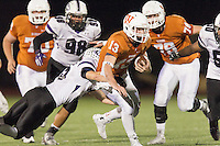 Westwood quarterback Jack Swensen gets tackled by Cedar Ridge's Brandon Zientek Friday at Dragon Stadium.