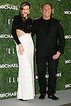 "(L to R) The model Miranda Kerr and the fashion designer Michael Kors pose for the cameras at the event ""Michael Kors in Japan"" in the Tokyo National Museum, November 13, 2013. She wears the dress of 2014 Collection designed by Michael Kors. The event is held to commemorate that Miranda Kerr with Michael Kors' dress will be on the cover of the magazine ""ELLE Japon"". (Photo by Rodrigo Reyes Marin/AFLO)"