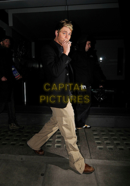 Brian McFADDEN <br /> Leaving Nobu, London, England.<br /> January 24th, 2008<br /> full length black jacket cigarette smoking walking beige cargo trousers combat brian <br /> CAP/SW<br /> &copy;SW/Capital Pictures