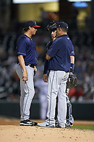 Toledo Mud Hens pitching coach Juan Nieves (right) has a meeting on the mound with starting pitcher Spenser Watkins (50) and catcher Bobby Wilson (37) during the game against the Charlotte Knights at BB&T BallPark on April 25, 2019 in Charlotte, North Carolina. The Mud Hens defeated the Knights 11-7. (Brian Westerholt/Four Seam Images)