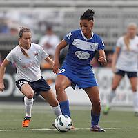 Boston Breakers forward Lianne Sanderson (10) dribbles as Sky Blue FC midfielder Manya Makoski (22) defends. In a National Women's Soccer League Elite (NWSL) match, Sky Blue FC (white) defeated the Boston Breakers (blue), 3-2, at Dilboy Stadium on June 16, 2013.