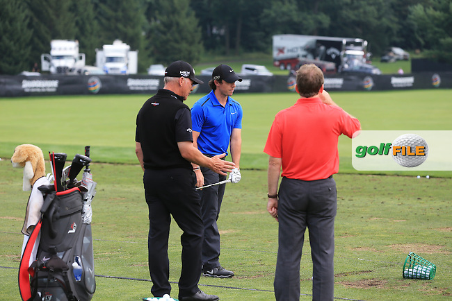 Rory McIlroy (NIR) with Michael Bannon and Pete Cowan on the range during Wednesday's Practice Day of the 2013 Bridgestone Invitational WGC tournament held at the Firestone Country Club, Akron, Ohio. 31st July 2013.<br /> Picture: Eoin Clarke www.golffile.ie