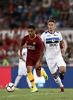 Calcio, Serie A: Roma - Atalanta, Stadio Olimpico, 27 agosto, 2018.<br /> Roma's Justin Kluivert (l) in action with Atalanta's Mario Pasalic (r) during the Italian Serie A football match between Roma and Atalanta at Roma's Stadio Olimpico, August 27, 2018.<br /> UPDATE IMAGES PRESS/Isabella Bonotto