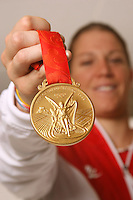 STANFORD, CA - September 5:  Nicole Barnhart, goalie for the U.S. National team poses with her Olympic gold medal from Beijing on September 5, 2008 in Stanford, California.