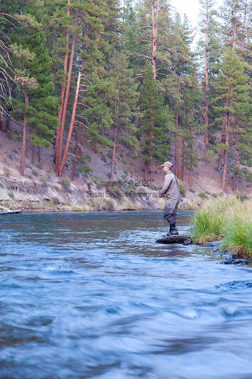 Fly Fishing on the Deschutes River near Bend, Oregon.  Cody Mellott casting in the late evening light.