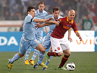 Calcio, Serie A: Roma vs Lazio. Roma, stadio Olimpico, 8 aprile 2013..AS Roma midfielder Michael Bradley, of the United States, right, is challenged by Lazio midfielders Senad Lulic, of Bosnia,  center, and Hernanes, of Brazil, during the Italian Serie A football match between AS Roma and Lazio at Rome's Olympic stadium, 8 April 2013..UPDATE IMAGES PRESS/Riccardo De Luca