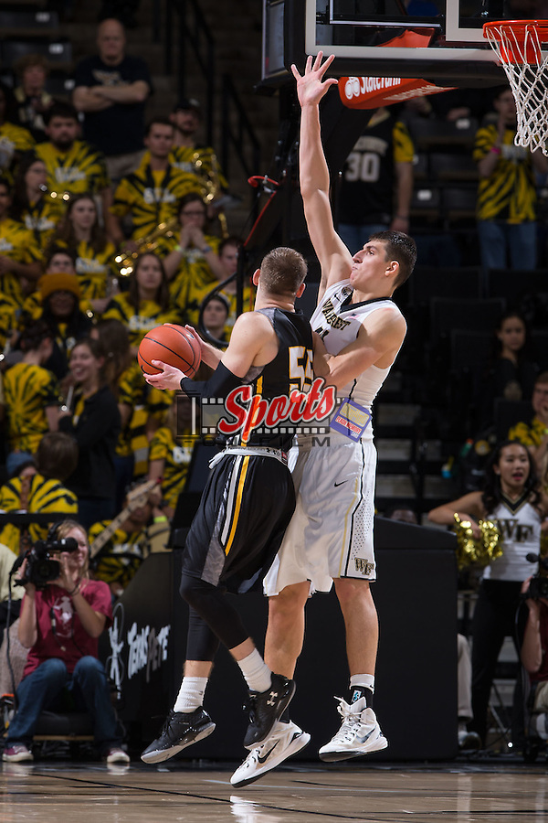 Dinos Mitoglou (44) of the Wake Forest Demon Deacons defends against Malcolm L. Brent (55) of the UMBC Retrievers during second half action at the LJVM Coliseum on November 13, 2015 in Winston-Salem, North Carolina.  The Demon Deacons defeated the Retrievers 78-73.  (Brian Westerholt/Sports On Film)