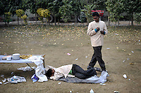 A worker takes a nap during a break from his shift at Grewal Farms, one of many wedding reception centres in Amritsar which employs hundreds of staff during the wedding season to work around the clock hosting day and night marriage ceremonies and parties.