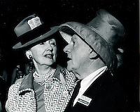 Hedda Hopper,gossip columnist and news broadcaster and commentator Walter Winchell trade hats while covering the Republican National Convention in San Francisco 1964 (photo by Ron Riesterer)