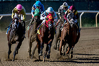 ELMONT, NY - JULY 09: The field turns for home in the Belmont Sprint Championship, eventually won by Limousine Liberal (white and black cap, rear) during Stars and Stripes Racing Festival  at Belmont Park on July 7, 2018 in Elmont, New York. (Photo by Dan Heary/Eclipse Sportswire/Getty Images)